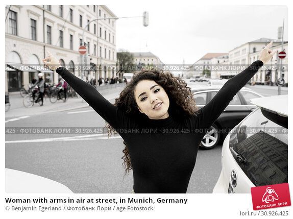 Купить «Woman with arms in air at street, in Munich, Germany», фото № 30926425, снято 6 мая 2019 г. (c) age Fotostock / Фотобанк Лори