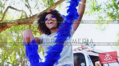 Купить «Woman with blue fur dancing at music festival 4k», видеоролик № 29705969, снято 9 марта 2017 г. (c) Wavebreak Media / Фотобанк Лори