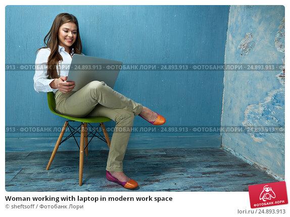 Woman working with laptop in modern work space, фото № 24893913, снято 26 мая 2016 г. (c) sheftsoff / Фотобанк Лори