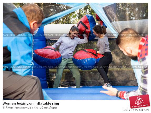 Women boxing on inflatable ring. Стоковое фото, фотограф Яков Филимонов / Фотобанк Лори