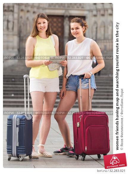 Купить «women friends having map and searching tourist route in the city», фото № 32283021, снято 29 мая 2017 г. (c) Яков Филимонов / Фотобанк Лори