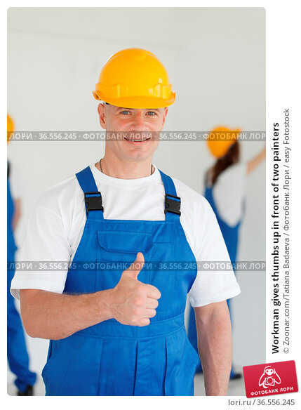 Workman gives thumbs up in front of two painters. Стоковое фото, фотограф Zoonar.com/Tatiana Badaeva / easy Fotostock / Фотобанк Лори
