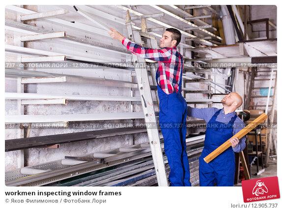 workmen inspecting window frames. Стоковое фото, фотограф Яков Филимонов / Фотобанк Лори