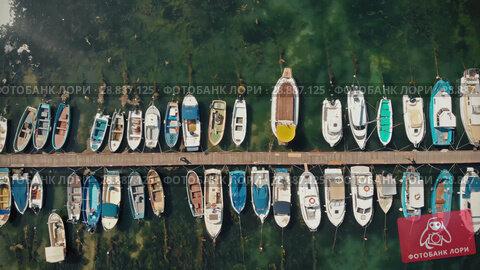 Купить «Yachts and boats in coast marine», видеоролик № 28887125, снято 20 июля 2018 г. (c) Илья Шаматура / Фотобанк Лори