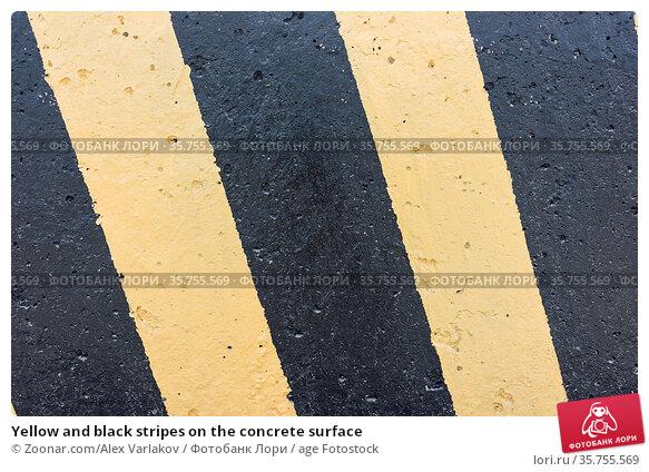 Yellow and black stripes on the concrete surface. Стоковое фото, фотограф Zoonar.com/Alex Varlakov / age Fotostock / Фотобанк Лори