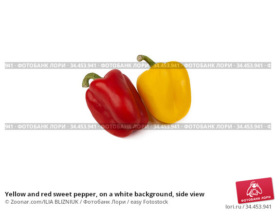 Yellow and red sweet pepper, on a white background, side view. Стоковое фото, фотограф Zoonar.com/ILIA BLIZNIUK / easy Fotostock / Фотобанк Лори