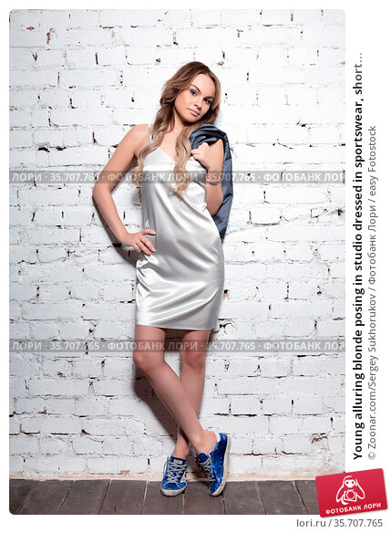Young alluring blonde posing in studio dressed in sportswear, short... Стоковое фото, фотограф Zoonar.com/Sergey Sukhorukov / easy Fotostock / Фотобанк Лори