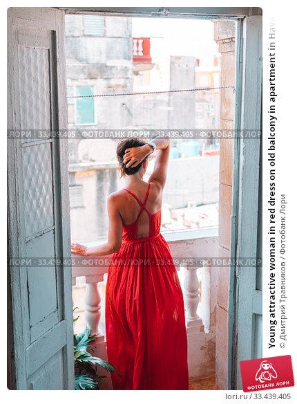 Купить «Young attractive woman in red dress on old balcony in apartment in Havana», фото № 33439405, снято 12 апреля 2017 г. (c) Дмитрий Травников / Фотобанк Лори