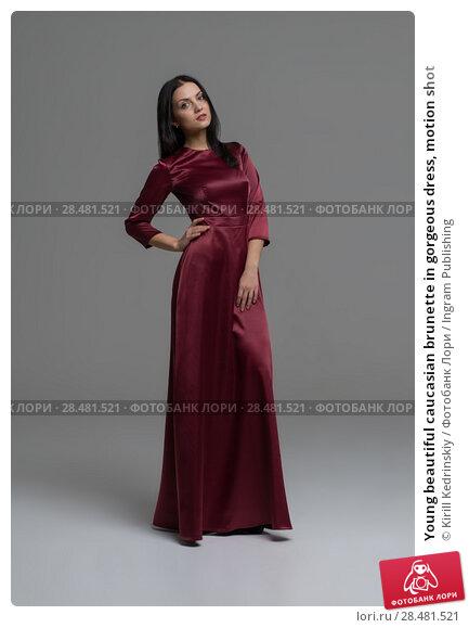 Купить «Young beautiful caucasian brunette in gorgeous dress, motion shot», фото № 28481521, снято 30 октября 2014 г. (c) Ingram Publishing / Фотобанк Лори
