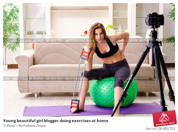 Young beautiful girl blogger doing exercises at home. Стоковое фото, фотограф Elnur / Фотобанк Лори
