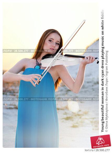 Купить «Young beautiful woman in dark cyan dress playing music on white fiddle», фото № 28500277, снято 30 июля 2013 г. (c) Ingram Publishing / Фотобанк Лори