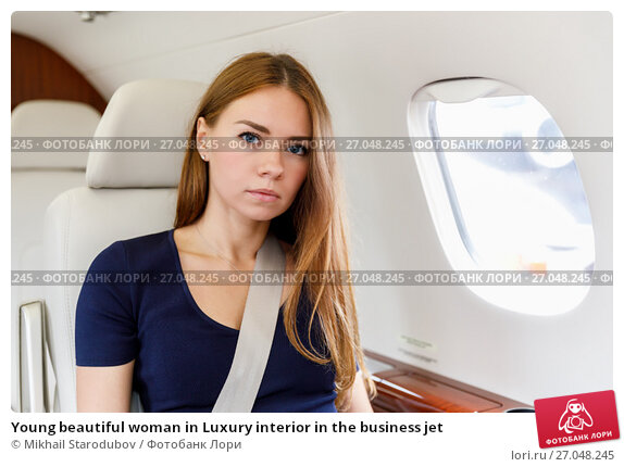 Купить «Young beautiful woman in Luxury interior in the business jet», фото № 27048245, снято 17 ноября 2019 г. (c) Mikhail Starodubov / Фотобанк Лори