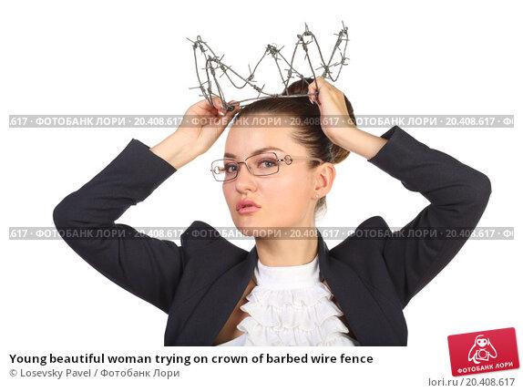 Купить «Young beautiful woman trying on crown of barbed wire fence», фото № 20408617, снято 7 июня 2014 г. (c) Losevsky Pavel / Фотобанк Лори