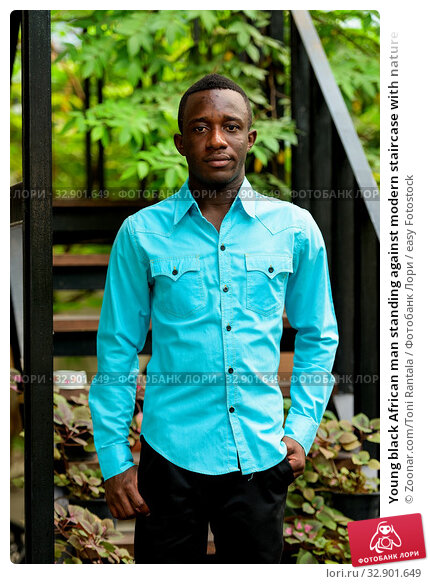 Young black African man standing against modern staircase with nature. Стоковое фото, фотограф Zoonar.com/Toni Rantala / easy Fotostock / Фотобанк Лори