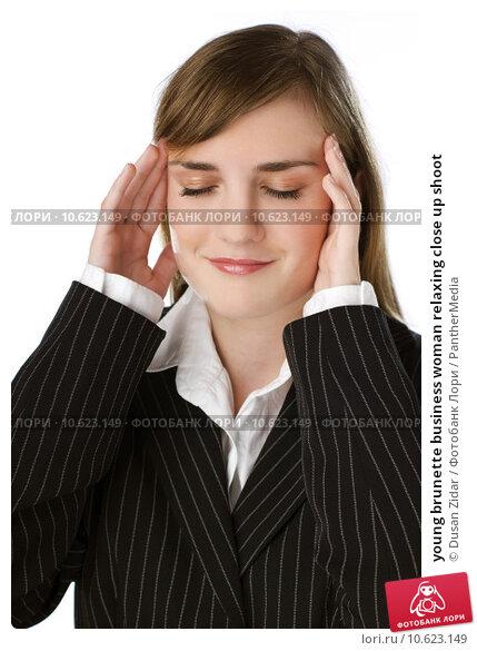 young brunette business woman relaxing close up shoot. Стоковое фото, фотограф Dusan Zidar / PantherMedia / Фотобанк Лори
