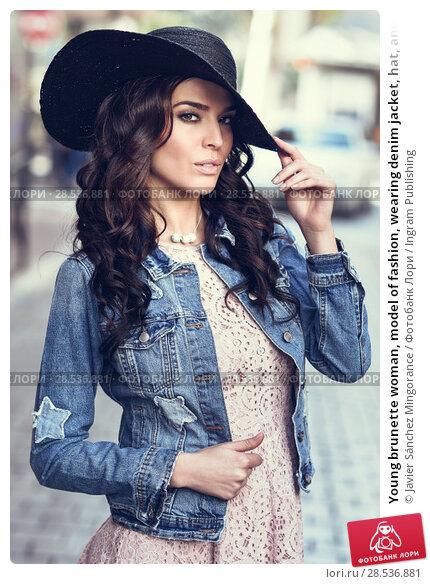 Купить «Young brunette woman, model of fashion, wearing denim jacket, hat, and pink dress. Pretty caucasian girl with long wavy hairstyle in urban background.», фото № 28536881, снято 11 марта 2017 г. (c) Ingram Publishing / Фотобанк Лори