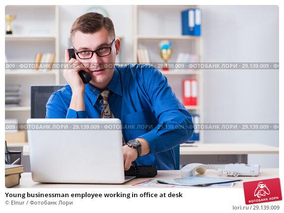 Купить «Young businessman employee working in office at desk», фото № 29139009, снято 2 февраля 2018 г. (c) Elnur / Фотобанк Лори