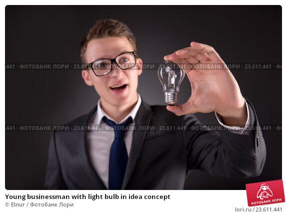 Young businessman with light bulb in idea concept. Стоковое фото, фотограф Elnur / Фотобанк Лори