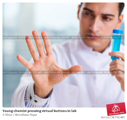 Young chemist pressing virtual buttons in lab. Стоковое фото, фотограф Elnur / Фотобанк Лори