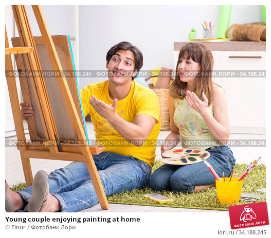 Young couple enjoying painting at home. Стоковое фото, фотограф Elnur / Фотобанк Лори