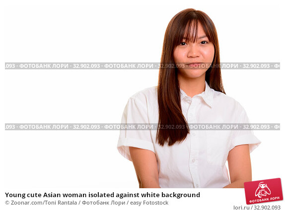 Young cute Asian woman isolated against white background. Стоковое фото, фотограф Zoonar.com/Toni Rantala / easy Fotostock / Фотобанк Лори