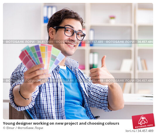Young designer working on new project and choosing colours. Стоковое фото, фотограф Elnur / Фотобанк Лори