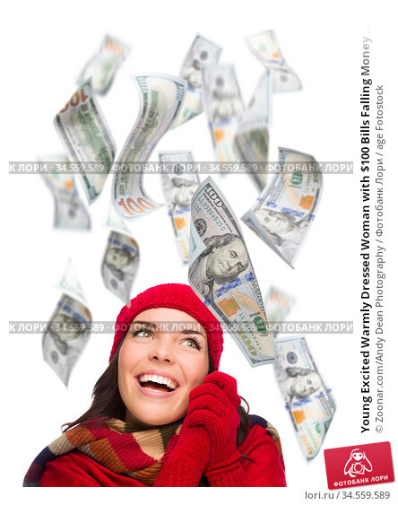 Young Excited Warmly Dressed Woman with $100 Bills Falling Money ... Стоковое фото, фотограф Zoonar.com/Andy Dean Photography / age Fotostock / Фотобанк Лори
