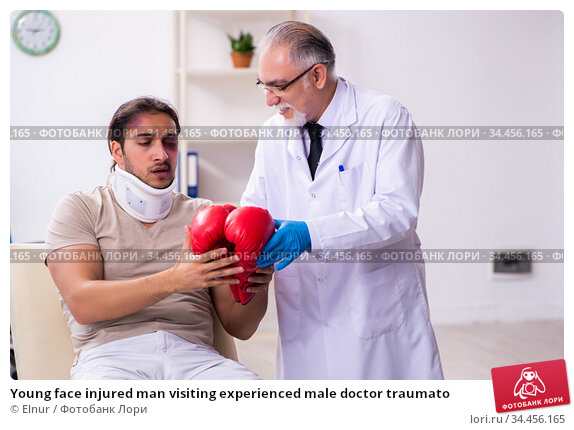 Young face injured man visiting experienced male doctor traumato. Стоковое фото, фотограф Elnur / Фотобанк Лори