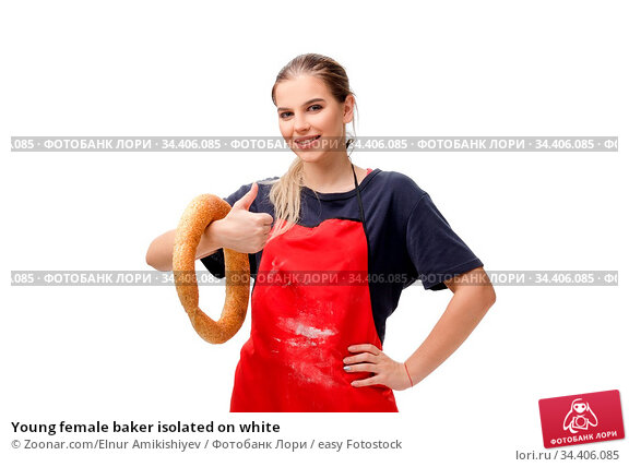 Young female baker isolated on white. Стоковое фото, фотограф Zoonar.com/Elnur Amikishiyev / easy Fotostock / Фотобанк Лори