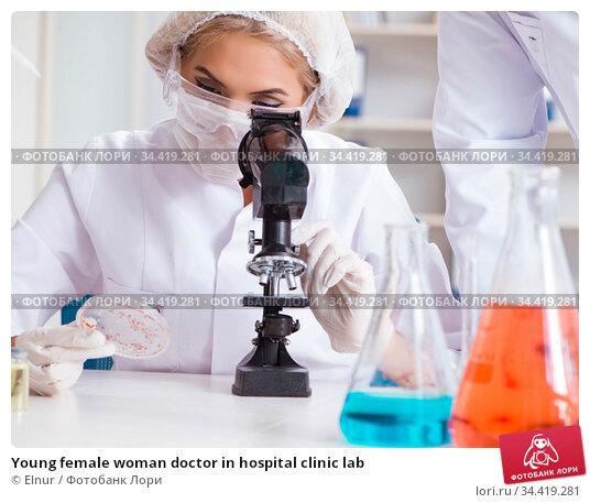 Young female woman doctor in hospital clinic lab. Стоковое фото, фотограф Elnur / Фотобанк Лори