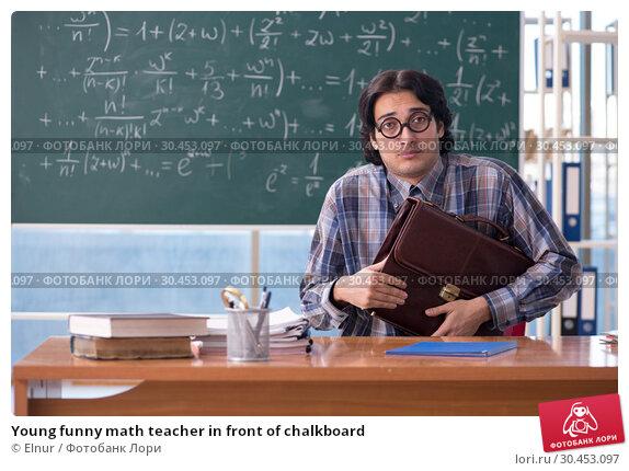 Young funny math teacher in front of chalkboard. Стоковое фото, фотограф Elnur / Фотобанк Лори