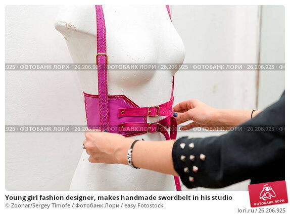 Купить «Young girl fashion designer, makes handmade swordbelt in his studio», фото № 26206925, снято 20 апреля 2019 г. (c) easy Fotostock / Фотобанк Лори
