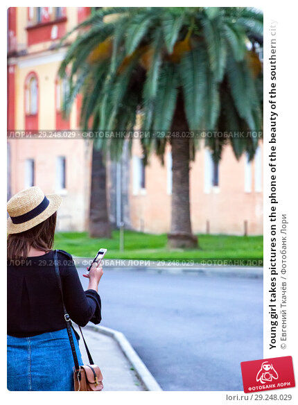 Купить «Young girl takes pictures on the phone of the beauty of the southern city», фото № 29248029, снято 19 июня 2018 г. (c) Евгений Ткачёв / Фотобанк Лори