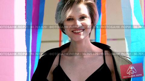 Купить «Young girl walks among multicolored ribbons», видеоролик № 30761829, снято 2 мая 2019 г. (c) Ekaterina Demidova / Фотобанк Лори
