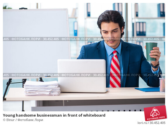 Young handsome businessman in front of whiteboard. Стоковое фото, фотограф Elnur / Фотобанк Лори