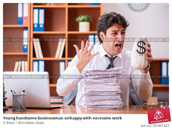 Купить «Young handsome businessman unhappy with excessive work», фото № 29457621, снято 8 августа 2018 г. (c) Elnur / Фотобанк Лори