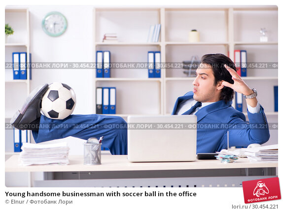 Young handsome businessman with soccer ball in the office. Стоковое фото, фотограф Elnur / Фотобанк Лори