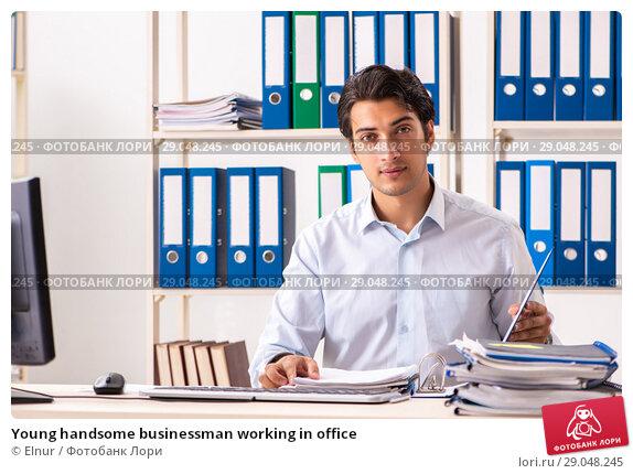 Купить «Young handsome businessman working in office», фото № 29048245, снято 7 июля 2018 г. (c) Elnur / Фотобанк Лори