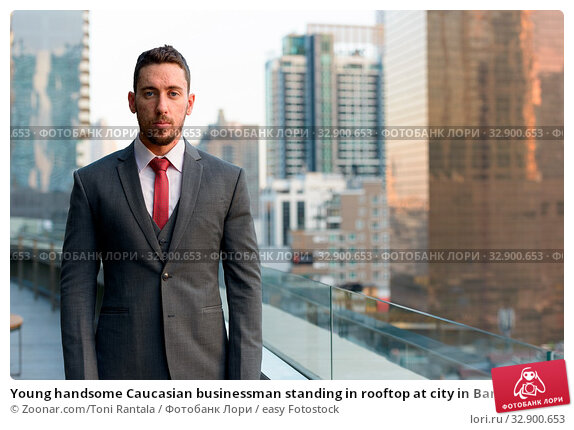 Young handsome Caucasian businessman standing in rooftop at city in Bangkok Thailand. Стоковое фото, фотограф Zoonar.com/Toni Rantala / easy Fotostock / Фотобанк Лори