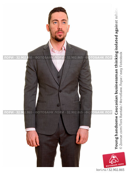 Young handsome Caucasian businessman thinking isolated against white background. Стоковое фото, фотограф Zoonar.com/Toni Rantala / easy Fotostock / Фотобанк Лори