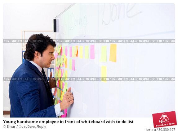 Купить «Young handsome employee in front of whiteboard with to-do list», фото № 30330197, снято 16 октября 2018 г. (c) Elnur / Фотобанк Лори