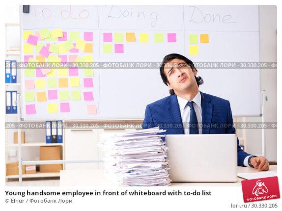 Купить «Young handsome employee in front of whiteboard with to-do list», фото № 30330205, снято 16 октября 2018 г. (c) Elnur / Фотобанк Лори