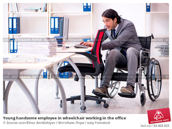 Young handsome employee in wheelchair working in the office. Стоковое фото, фотограф Zoonar.com/Elnur Amikishiyev / easy Fotostock / Фотобанк Лори