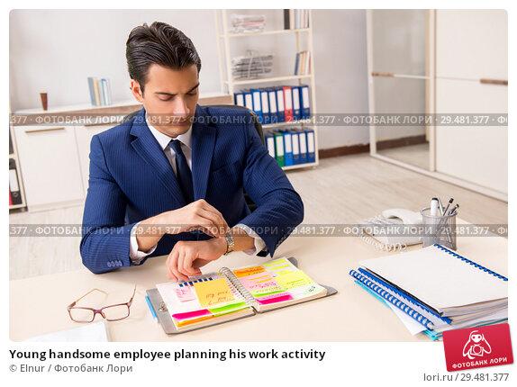 Купить «Young handsome employee planning his work activity», фото № 29481377, снято 1 августа 2018 г. (c) Elnur / Фотобанк Лори