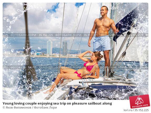 Young loving couple enjoying sea trip on pleasure sailboat along. Стоковое фото, фотограф Яков Филимонов / Фотобанк Лори