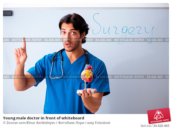 Young male doctor in front of whiteboard. Стоковое фото, фотограф Zoonar.com/Elnur Amikishiyev / easy Fotostock / Фотобанк Лори