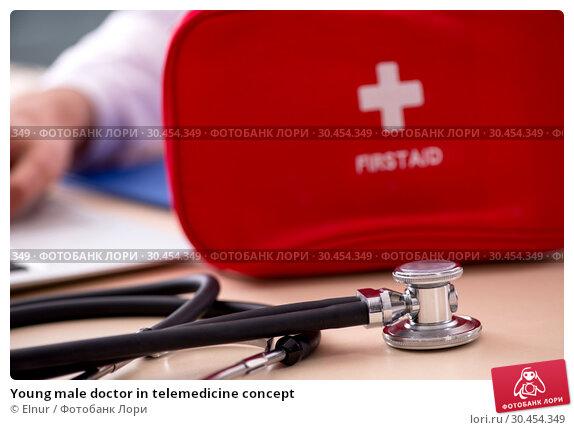 Young male doctor in telemedicine concept. Стоковое фото, фотограф Elnur / Фотобанк Лори