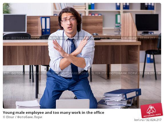 Купить «Young male employee and too many work in the office», фото № 32024217, снято 9 мая 2019 г. (c) Elnur / Фотобанк Лори