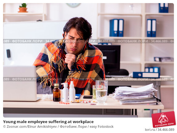 Young male employee suffering at workplace. Стоковое фото, фотограф Zoonar.com/Elnur Amikishiyev / easy Fotostock / Фотобанк Лори