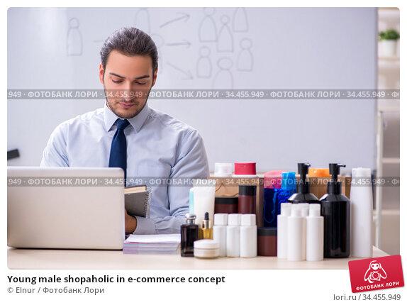 Young male shopaholic in e-commerce concept. Стоковое фото, фотограф Elnur / Фотобанк Лори